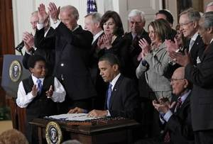 photo - In this March 23, 2010 file photo, President Barack Obama is applauded after signing the health care bill in the East Room of the White House in Washington. Obama's terrible, horrible, no good, very bad year got off to a terrible, horrible, no good, very bad start. (AP Photo/Charles Dharapak, File)