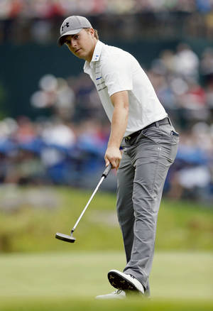 Photo - Jordan Spieth guides his eagle putt on the 18th hole during the final round of the Deutsche Bank Championship golf tournament in Norton, Mass., Monday, Sept. 2, 2013. (AP Photo/Michael Dwyer)