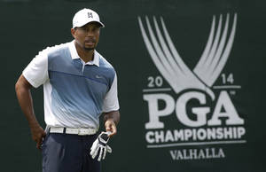 Photo - Tiger Woods stands on the first tee during a practice round for the PGA Championship golf tournament at Valhalla Golf Club on Wednesday, Aug. 6, 2014, in Louisville, Ky. The tournament is set to begin on Thursday. (AP Photo/David J. Phillip)