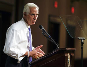 "Photo - FILE -This May 21, 2014 file photo shows Florida Democratic gubernatorial candidate Charlie Crist campaigning in Orlando, Fla. Recently, campaigning in Miami's Little Havana, Crist stood before a crowd and said what few politicians have in decades of scrounging for votes in the Cuban-American neighborhood: end the trade embargo against Cuba. ""If you really care about people on the island, we need to get rid of the embargo and let freedom reign,"" he said, shouting above a small band of protesters who responded with chants of ""Shame on you!"" Crist's supporters cheered louder.  (AP Photo/John Raoux, File)"