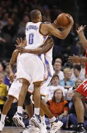 Photo - Russell  Westbrook colides with Joe Smith on a rebound in the first half as the Oklahoma City Thunder plays the Houston Rockets at the Ford Center in Oklahoma City, Okla. on Friday, January 9, 2009. Photo by Steve Sisney/The Oklahoman