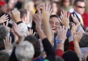 Photo -   Republican presidential candidate, former Massachusetts Gov. Mitt Romney greets supporters during a campaign rally in Lancaster, Ohio, Friday, Oct. 12, 2012. (AP Photo/Paul Vernon)