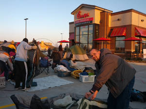 photo - Chick-fil-A fans set up tents in preparation for a 24-hour campout at Oklahoma City's newest location in an attempt to win a year's worth of free food.  PHOTOS PROVIDED