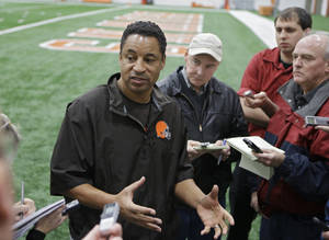 Photo - Cleveland Browns defensive coordinator Ray Horton talks to reporters after practicer at the NFL football team's facility in Berea, Ohio Thursday, Dec. 19, 2013. Turner address the fourth quarter defensive collapses the Browns have suffered in the last few games. (AP Photo/Mark Duncan)