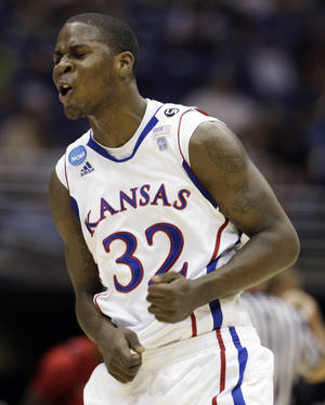 Photo - Kansas' Josh Selby reacts against Richmond during the first half of a Southwest regional semifinal game in the NCAA college basketball tournament Friday, March 25, 2011, in San Antonio.  (AP Photo/Tony Gutierrez)