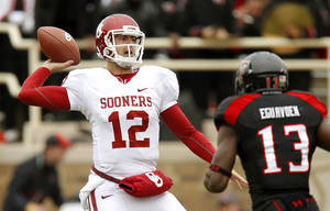 Photo - Oklahoma's Landry Jones (12) throws a pass during a college football game between the University of Oklahoma (OU) and Texas Tech University at Jones AT&T Stadium in Lubbock, Texas, Saturday, Oct. 6, 2012. Photo by Bryan Terry, The Oklahoman