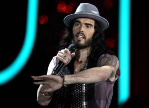 Photo -   Russell Brand appears onstage at the MTV Movie Awards on Sunday, June 3, 2012, in Los Angeles. (Photo by Matt Sayles/Invision/AP)