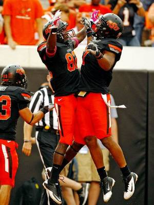 Photo - Oklahoma State's Isaiah Anderson celebrates his touchdown reception with Oklahoma State's Michael Harrison (7) during a college football game between the Oklahoma State University Cowboys (OSU) and the University of Kansas Jayhawks (KU) at Boone Pickens Stadium in Stillwater, Okla., Saturday, Oct. 8, 2011 Photo by Steve Sisney, The Oklahoman <strong>STEVE SISNEY</strong>
