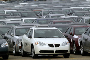 Photo -   Rows of Pontiac G6 cars are seen March 16, 2006, outside of the General Motors Orion Assembly plant in Orion Township, Mich.  AP File Photo  <strong>Paul Sancya -  AP </strong>