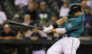 Photo - Seattle Mariners' Justin Smoak hits a two-run go-ahead double in the eighth inning of a baseball game against the Tampa Bay Rays, Friday, Sept. 6, 2013, in Seattle. (AP Photo/Ted S. Warren)
