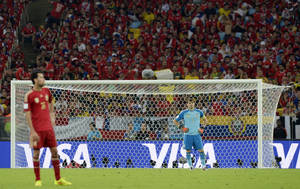 Photo - Spain's goalkeeper Iker Casillas stands in his goal mouth during the group B World Cup soccer match between Spain and Chile at the Maracana Stadium in Rio de Janeiro, Brazil, Wednesday, June 18, 2014.  (AP Photo/Manu Fernandez)