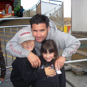 Photo - FILE - This undated file photo provided Tuesday April 5, 2011 by John Stow shows Bryan Stow holding his 12-year-old son and 8-year-old daughter. Bryan Stow a San Francisco Giants fan who suffered brain damage in a beating at Dodger Stadium won his negligence suit against the Los Angeles Dodgers on Wednesday, but former owner Frank McCourt  was absolved by the jury, Wednesday July 9, 2014.(AP Photo/John Stow, File)