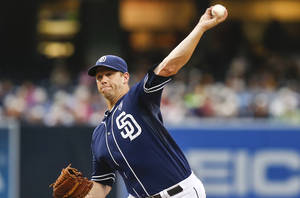 Photo - San Diego Padres starting pitcher Eric Stults works against the Arizona Diamondbacks during the first inning of a baseball game Saturday, June 28, 2014, in San Diego. (AP Photo/Lenny Ignelzi)