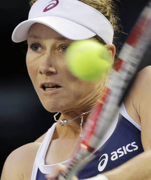 Photo -   Samantha Stosur of Australia returns the ball against Maria Sharapova of Russia during the quarterfinal at the Pan Pacific Open Tennis in Tokyo,Thursday, Sept. 27, 2012. (AP Photo/Koji Sasahara)