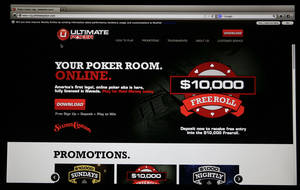 Photo - The home page for Ultimate Poker by the company Ultimate Gaming is seen on a computer screen at the company's headquarters, Monday, April 29, 2013, in Las Vegas.  The social gaming company is expected to launch the first legal, real-money poker site in the U.S. Tuesday morning. The Ultimate Gaming site will be available only to in players in Nevada, but likely represents the shape of things to come for gamblers across the country. (AP Photo/Julie Jacobson)