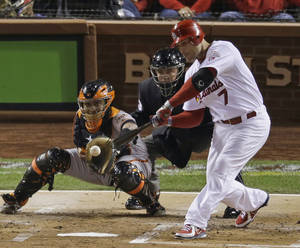 Photo -   St. Louis Cardinals' Matt Holliday hits an RBI single during the first inning of Game 4 of baseball's National League championship series against the San Francisco Giants Thursday, Oct. 18, 2012, in St. Louis. (AP Photo/Mark Humphrey)