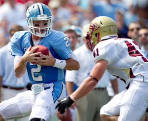 photo -   North Carolina quarterback Bryn Renner (2) catches a pass from wide receiver Erik Highsmith (88) in the second quarter against Elon in an NCAA college football game, Saturday Sept. 1, 2012, at Kenan Stadium in Chapel Hill, N.C. (AP Photo/The News & Observer, Robert Willett) MANDATORY CREDIT