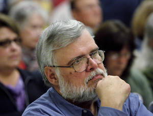 photo - Jim Gorges, a retired Air Force officer who lives in Oklahoma City, listens to remarks by a speaker at the state Capitol Tuesday morning, March 12. Photo by Jim Beckel, The Oklahoman <strong>Jim Beckel</strong>