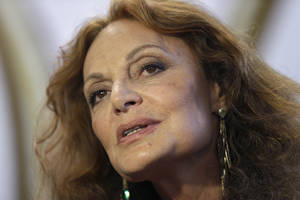 Photo - Designer Diane von Furstenberg speaks to reporters backstage before showing her Fall 2014 collection during Fashion Week in New York, Sunday, Feb. 9, 2014. (AP Photo/Seth Wenig)