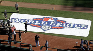 photo -   Workers paint a logo on the field at AT&T Park before workouts for baseball's World Series Tuesday, Oct. 23, 2012, in San Francisco. The Detroit Tigers play the San Francisco Giants in Game 1 on Wednesday, Oct. 24. (AP Photo/Eric Risberg)
