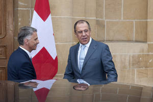 Photo - Russian Foreign Minister Sergei Lavrov, right, is welcomed by Switzerland's Federal Councillor and Foreign Minister Didier Burkhalter, left, for a working visit a Neuchatel, Switzerland, Friday, April 12, 2013. (AP Photo/Keystone/Sandro Campardo)
