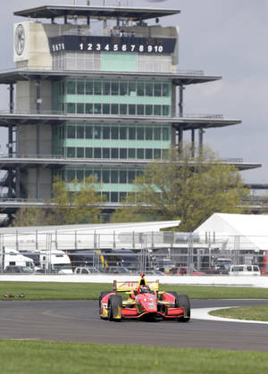 Photo - Sebastian  Saavedra, of Colombia, takes a turn during testing for the inaugural Grand Prix of Indianapolis auto race on the new road course at Indianapolis Motor Speedway in Indianapolis, Wednesday, April 30, 2014. (AP Photo/Michael Conroy)
