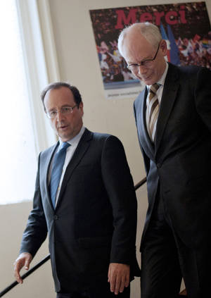 Photo -   France's president-elect Francois Hollande, left, walks down stairs with European Council President Herman Van Rompuy after a meeting at his campaign headquarters in Paris, Wednesday, May 9, 2012. (AP Photo/Fred Dufour, Pool)
