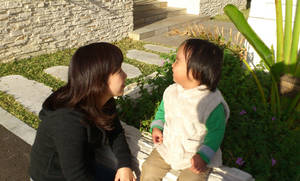 Photo - In this photo released by Minaho Kubota, Kubota chats with her two-year-old son in Naha, Okinawa, Japan. Petrified of the radiation spewing from the Fukushima Dai-ichi nuclear plant that went into multiple meltdowns last year, Kubota grabbed her children, left her skeptical husband and moved to the small southwestern island. AP photo <strong> - AP photo</strong>