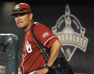 Photo - Oklahoma coach Sonny Golloway looks on after the Sooners' 3-2 loss to South Carolina on Thursday. AP PHOTO