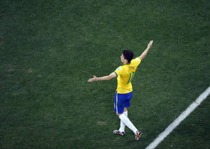 Photo - Brazil's Oscar celebrates his goal in the second half during the group A World Cup soccer match between Brazil and Croatia, during the opening game of the tournament, in the Itaquerao Stadium in Sao Paulo, Brazil, Thursday, June 12, 2014. (AP Photo/Fabrizio Bensch, Pool)
