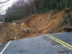 Photo - CORRECTS SOURCE AND REMOVES BYLINE - In this photo provided by the Great Smoky Mountains National Park, work to repair a landslide that took out a section of a Smoky Mountains highway between Newfound Gap and Smokemount, Tenn. is underway on Tuesday, Jan. 29, 2013. (AP Photo/Great Smoky Mountains National Park)