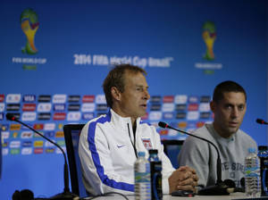 Photo - United States' head coach Jurgen Klinsmann, left, speaks flanked by attacker Clint Dempsey during a press conference the day before the World Cup round of 16 soccer match between Belgium and the U.S. at Arena Fonte Nova in Salvador, Brazil, Monday, June 30, 2014. (AP Photo/Julio Cortez)