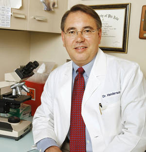 Photo - Dr. Jeff Henderson at the Britton Road Veterinary Clinic in Oklahoma City Wednesday, July 10, 2013.  For story on Ticks in Oklahoma. Photo by Paul B. Southerland, The Oklahoman