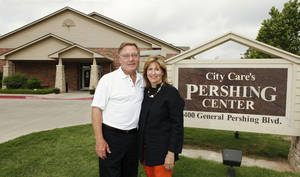 Photo - Larry and Masie Bross pose outside the Pershing Center. They have been helping the poor and homeless for years. <strong>PAUL B. SOUTHERLAND - PAUL B. SOUTHERLAND</strong>
