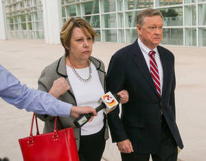 Photo - Former Fiesta Bowl executive director John Junker walks out of Sandra Day O'Connor U.S. Courthouse after being sentenced in Phoenix on Thursday, March 13,  2014. Junker was sentenced to eight months in federal prison for participating in a scheme in which bowl employees made illegal campaign contributions to politicians and were reimbursed by the nonprofit bowl. (AP Photo/The Arizona Republic, Michael Schennum)  MARICOPA COUNTY OUT; MAGS OUT; NO SALES