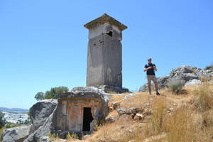 Photo - Behind John Zubialde is a Lycian pillar tomb. The land of Lycia is located in southwest Turkey. Photo provided <strong></strong>