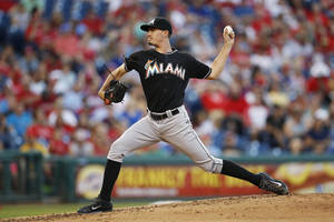 Photo - Miami Marlins' Andrew Heaney pitches during the second inning of a baseball game against the Philadelphia Phillies, Tuesday, June 24, 2014, in Philadelphia. (AP Photo/Matt Slocum)