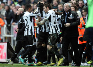 Photo - Newcastle United's Moussa Sissoko, center, celebrates his goal with his teammates and manager Alan Pardew, right, during their English Premier League soccer match against Chelsea at St James' Park, Newcastle, England, Saturday, Feb. 2, 2013. (AP Photo/Scott Heppell)