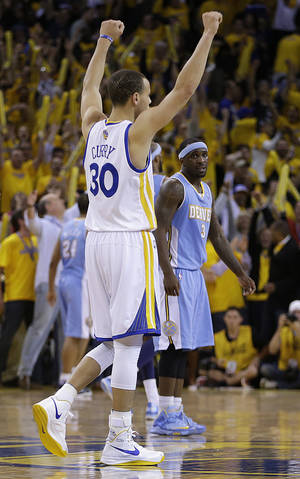 Photo - Golden State Warriors' Stephen Curry (30) reacts as Denver Nuggets' Ty Lawson watches, right, at the end of Game 3 in a first-round NBA basketball playoff series on Friday, April 26, 2013, in Oakland, Calif. (AP Photo/Ben Margot)