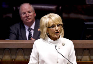 photo - Speaker of the House Andy Tobin, R-Paulden, left, listens as Arizona Gov. Jan Brewer gives her State of the State address at the Arizona Capitol, Monday, Jan. 14, 2013, in Phoenix. (AP Photo/Ross D. Franklin)