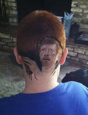 Photo -   This family photo shows Patrick Gonzalez, 12, with an image of San Antonio Spurs' Matt Bonner shaved into his head, at his home in San Antonio on Tuesday, May 15, 2012. Gonzalez was suspended for a day from Woodlake Hills Middle School because the district deemed his $75 haircut a distraction. He returned to class Thursday after reluctantly shaving his head. (AP Photo/Rachel Delgado)