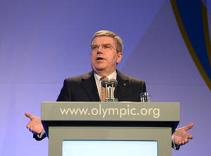 Photo - President of the International Olympic Committee Thomas Bach delivers his speech at the IOC Gala Dinner on the eve of the opening ceremony of the 2014 Winter Olympics, Thursday, Feb. 6, 2014, in Sochi, Russia.  (AP Photo/Andrej Isakovic, Pool)