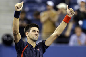 photo -   Novak Djokovic, of Serbia, reacts after defeating Juan Martin del Potro, of Argentina, in a quarterfinals match at the U.S. Open tennis tournament, Thursday, Sept. 6, 2012, in New York. Djokovic won 6-2, 7-6 (3), 6-4. (AP Photo/Darron Cummings)