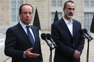 Photo -   French President Francois Hollande, left, and head of the new Syrian National Coalition for Opposition and Revolutionary Forces Mouaz al-Khatib, right, give a press conference after a meeting, at the Elysee Palace, in Paris, Saturday, Nov. 17, 2012. French President Francois Hollande and the new Syrian opposition leader have announced plans to install a new ambassador to represent Syria in France. The announcement came after talks Saturday at the presidential palace in Paris between Hollande and Moaz al-Khatib, head of the newly formed Syrian opposition coalition. France is the only Western country to have formally recognized the group as the representative of the Syrian people. (AP Photo/Thibault Camus)