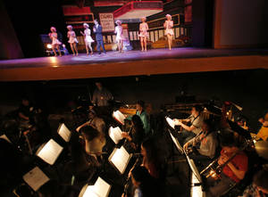 "Photo - Students rehearse for ""Crazy for You"" on Tuesday at Edmond North High School."