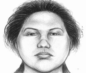 photo - In this image provided by the New York City Police Department, a composite sketch showing the woman believed to have pushed a man to his death in front of a subway train on Thursday, Dec. 27, 2012 is shown. Police arrested Erika Menendez on Saturday, Dec. 29, 2012, after a passer-by on a street noticed she resembled the woman seen in a surveillance video. The attack was the second time this month that a man was pushed to his death in a city subway station. (AP Photo/New York City Police Department)