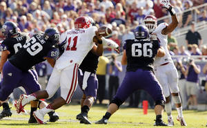 Photo - Oklahoma's R.J. Washington (11) forces a fumble by Trevone Boykin (2) during the second half of the college football game where the University of Oklahoma Sooners (OU) defeated the Texas Christian University Horned Frogs (TCU) 24-17 at Amon G. Carter Stadium in Fort Worth, Texas, on Saturday, Dec. 1, 2012. Photo by Steve Sisney, The Oklahoman