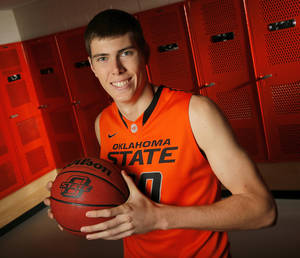 Photo - COLLEGE BASKETBALL: OSU's Mason Cox (30) poses for a photo during basketball media day for Oklahoma State University at Gallagher-Iba Arena in Stillwater, Okla., Monday, Oct. 22, 2012. Photo by Nate Billings, The Oklahoman