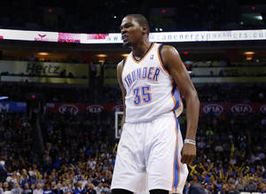 Photo - Oklahoma City 's Kevin Durant (35) reacts after making a shot during an NBA preseason game between the Oklahoma City Thunder and the Denver Nuggets at Chesapeake Energy Arena on Tuesday, october 15, 2013. Tuesday, Oct. 15, 2013. Photo by Bryan Terry, The Oklahoman