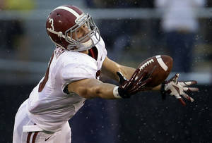 Photo -   Alabama defensive back Vinnie Sunseri intercepts a pass during the first quarter of an NCAA college football game against Missouri Saturday, Oct. 13, 2012, in Columbia, Mo. (AP Photo/Jeff Roberson)